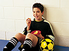 Boy eating a snack after soccer practice